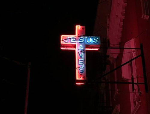 jesus saves neon signage