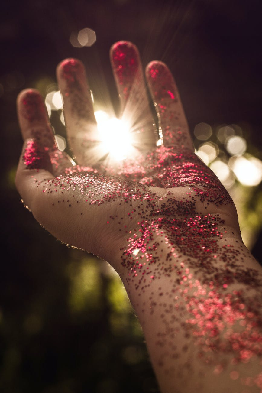 left person s arm with red glitter